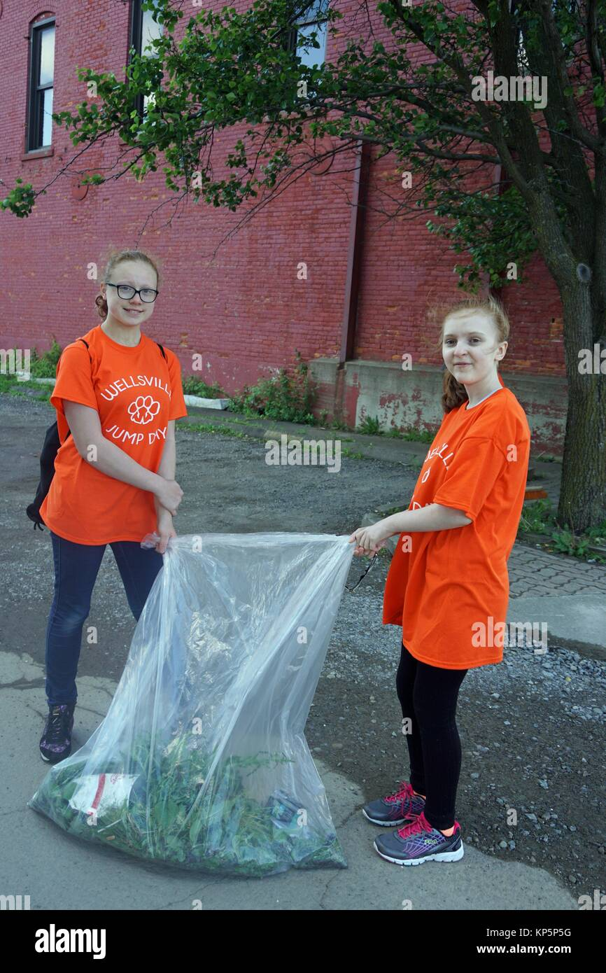 Middle School Girls Collecting Debris for Community Service Day, Wellsville, New York, USA. - Stock Image