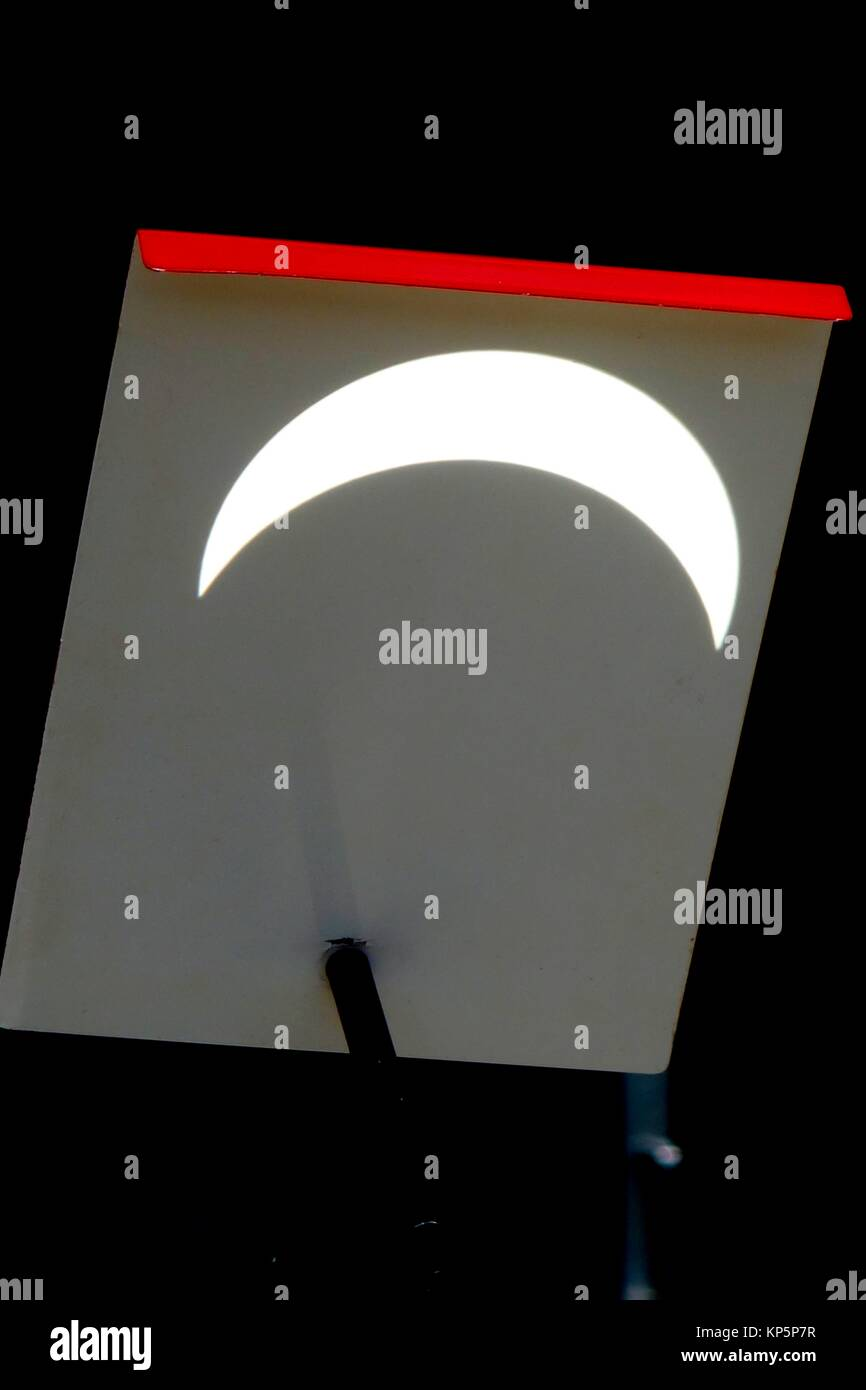 Solar Eclipse Reflected on Telescope Attachment, Wellsville, New York, USA. - Stock Image