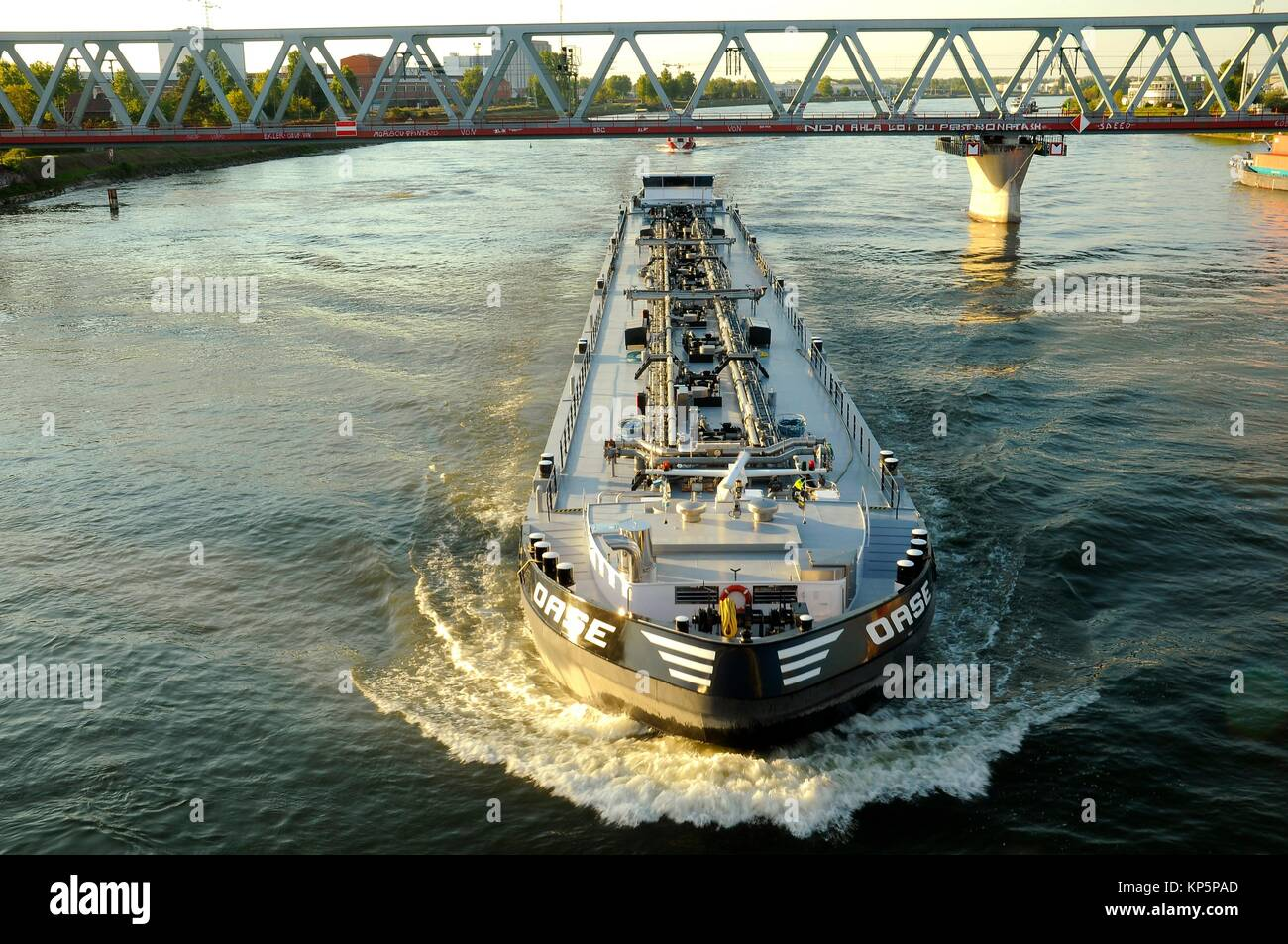 Nautical Vessel navigate on the Rhein river between Germany and France - Stock Image