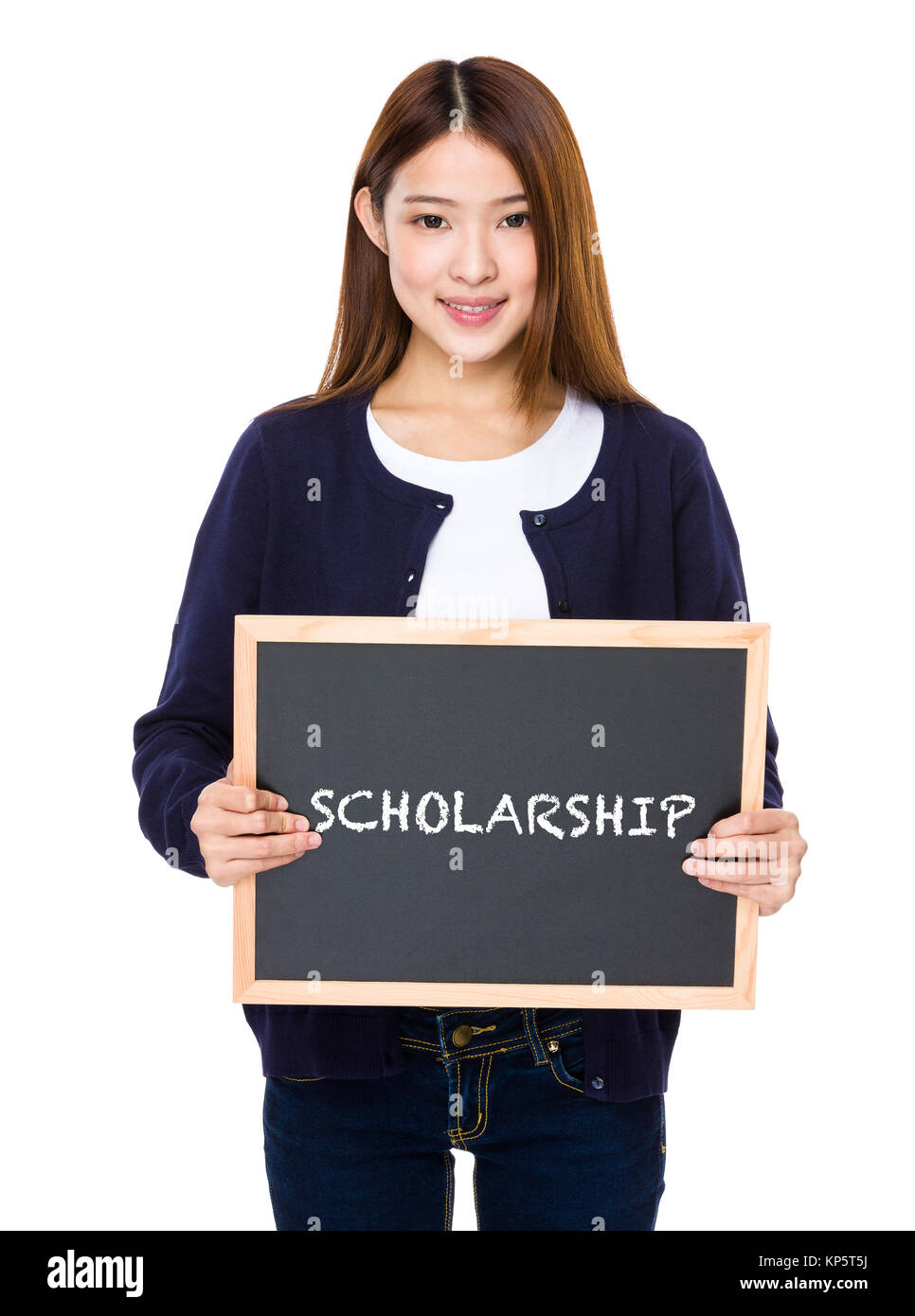 Asian woman with chalkboard showing a word scholarship - Stock Image