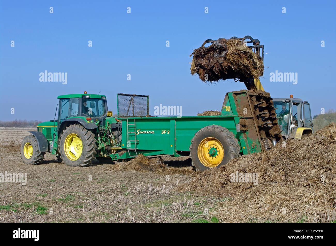 John Deere 6800 tractor and muck spreader - Stock Image