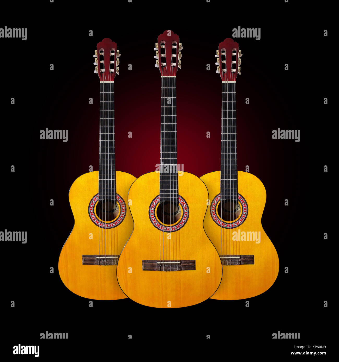 Musical instrument - Three Classic guitar on a dark background. - Stock Image