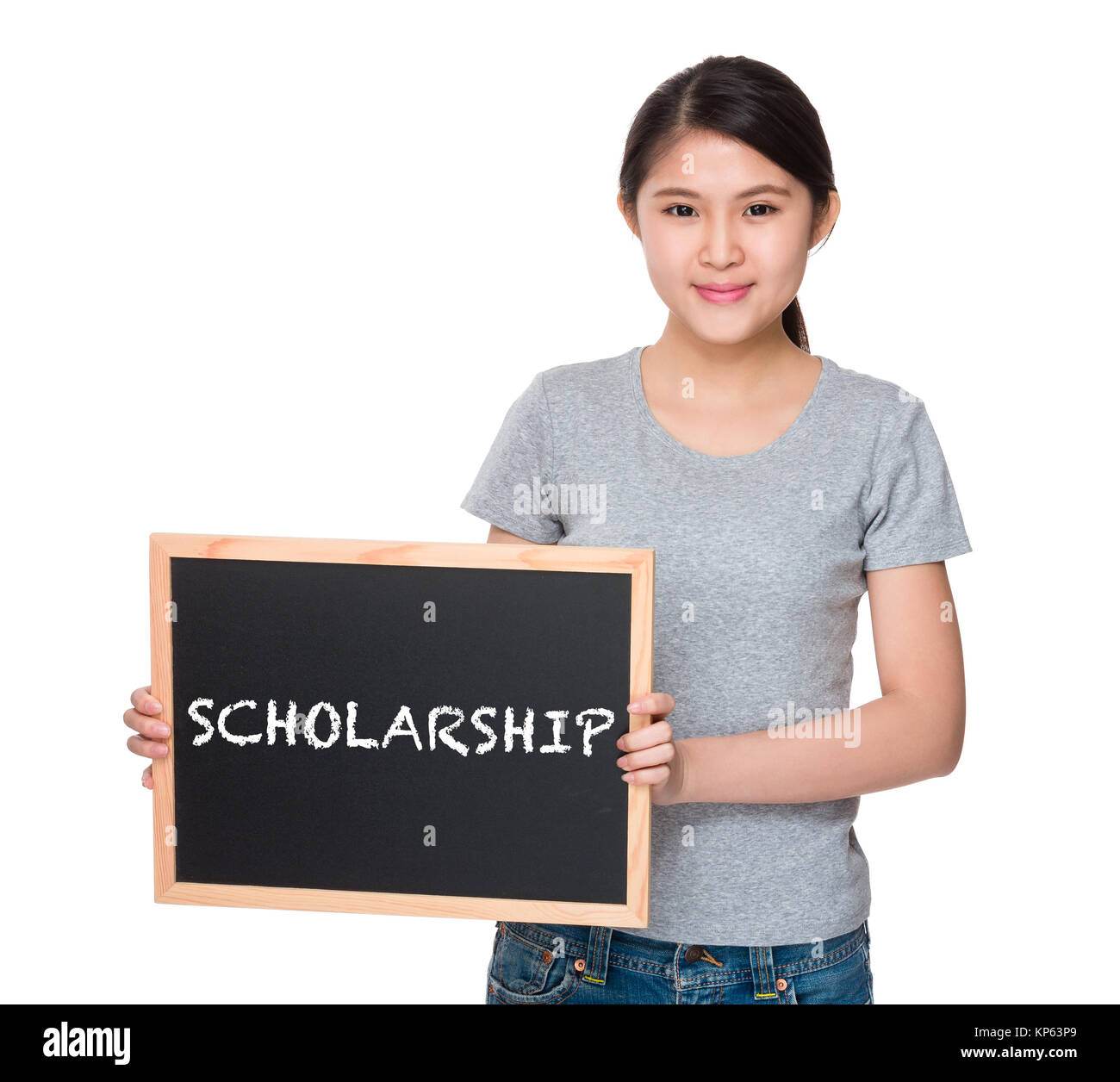 Young woman with the blackboard and showing a word scholarship - Stock Image