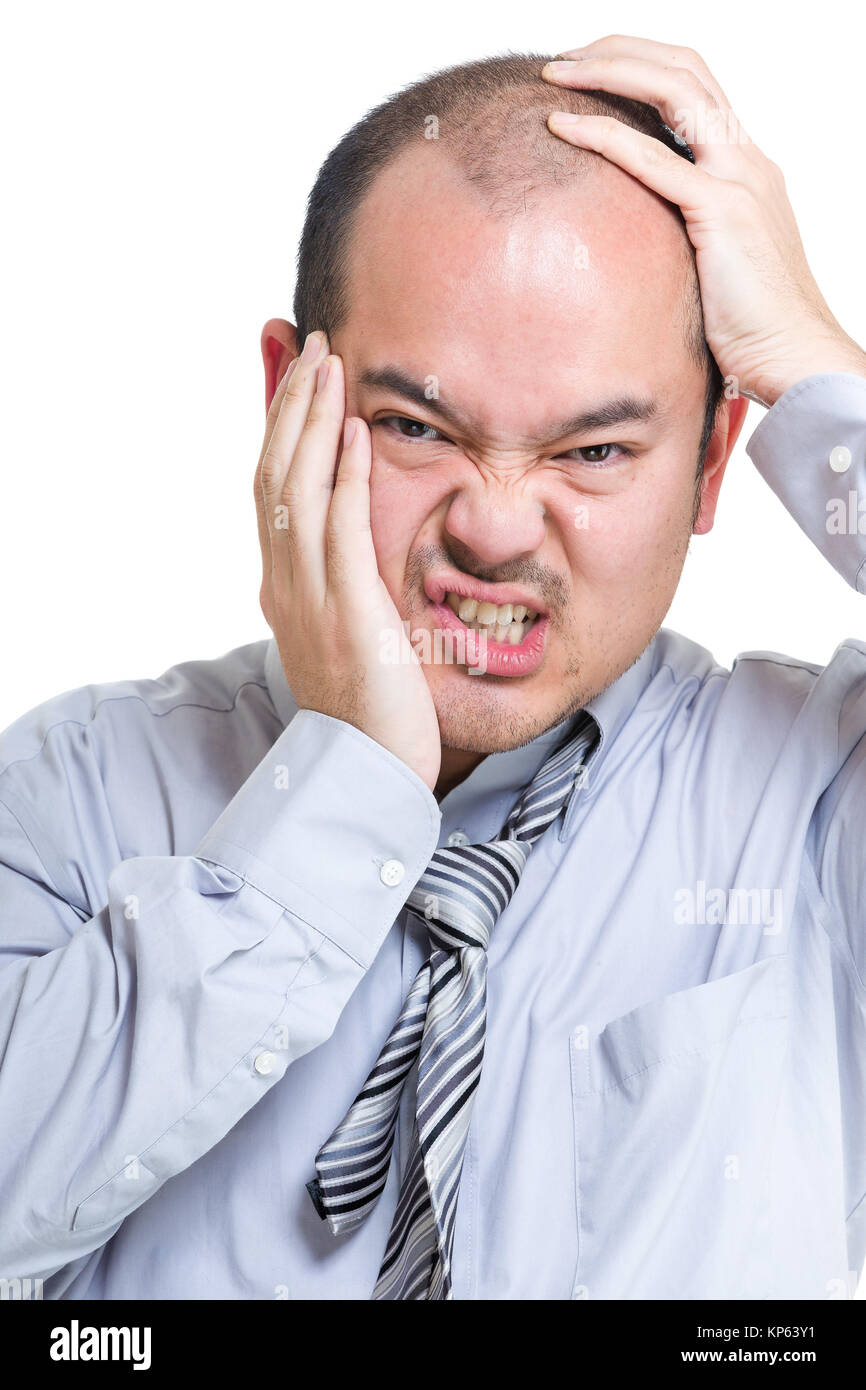 Businessman suffer from toothache and headache - Stock Image