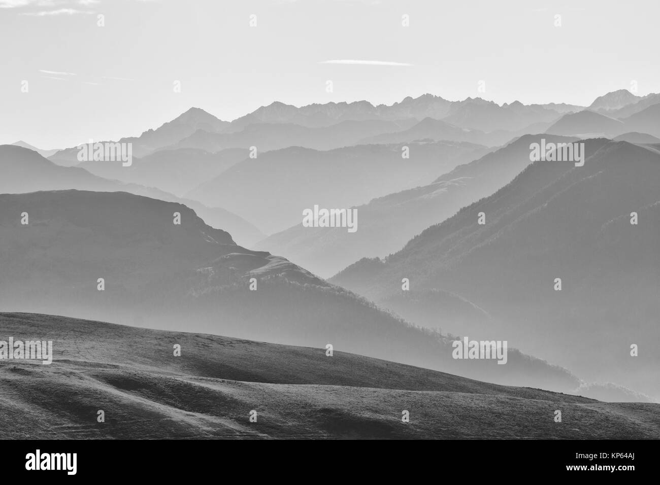 Mist in the rising sun in the Pyrenees mountain range, France - Stock Image