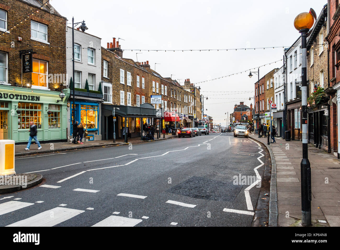 The high street in Highgate Village, London, UK, on a December evening Stock Photo