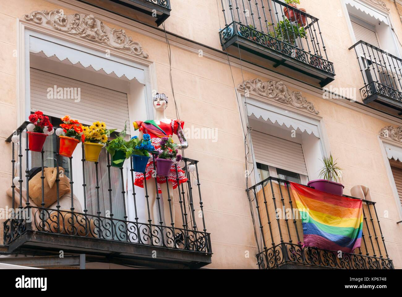 Flags in balconies during gay pride festival. Chueca district. Madrid. Spain. - Stock Image