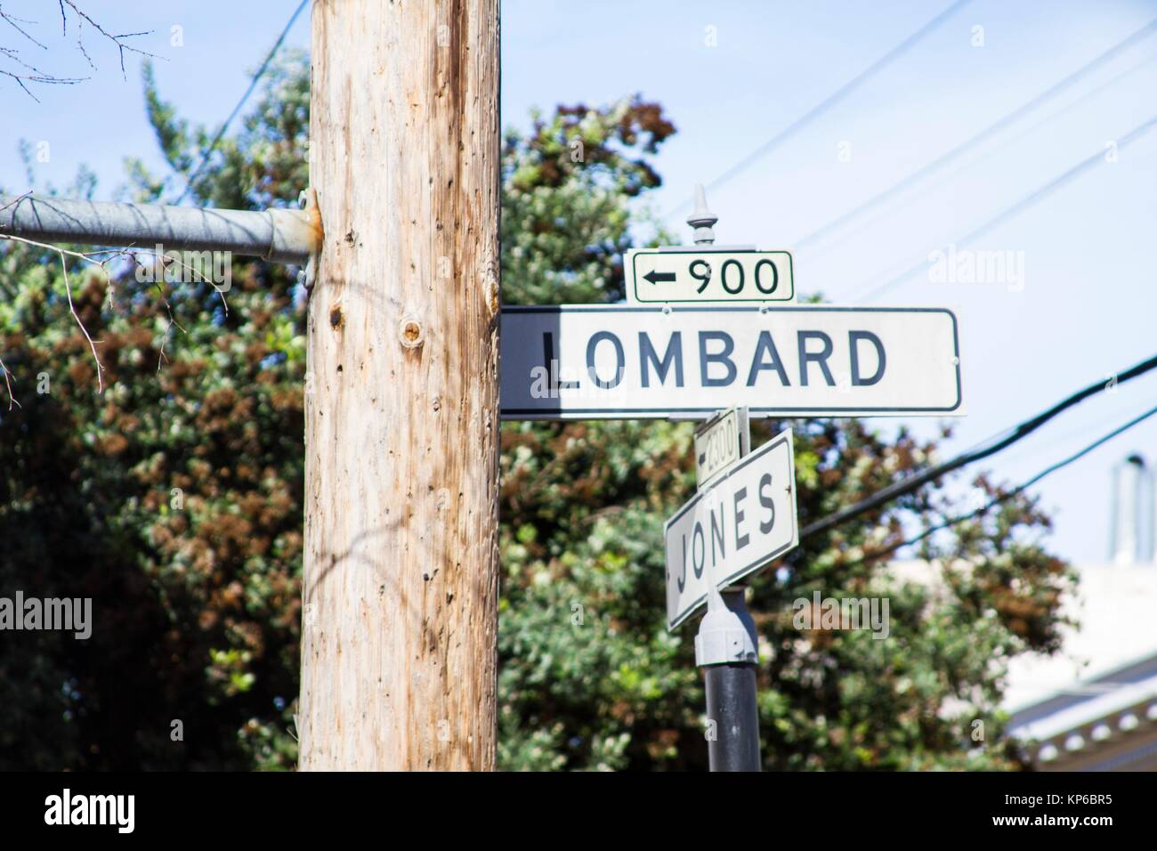 View of the white streets signs of the famous of Lombard street in San Francisco at an intersection on a blue sky Stock Photo