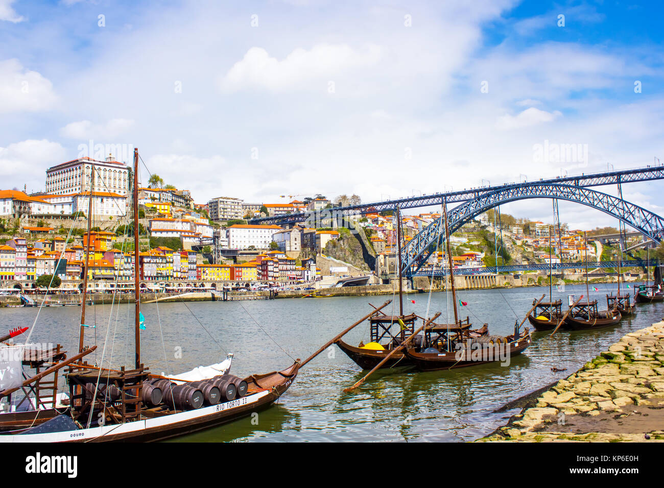General view of Oporto, Portugal. Are visible the D. Luis bridge, the Douro river and a few boats that used to transport - Stock Image
