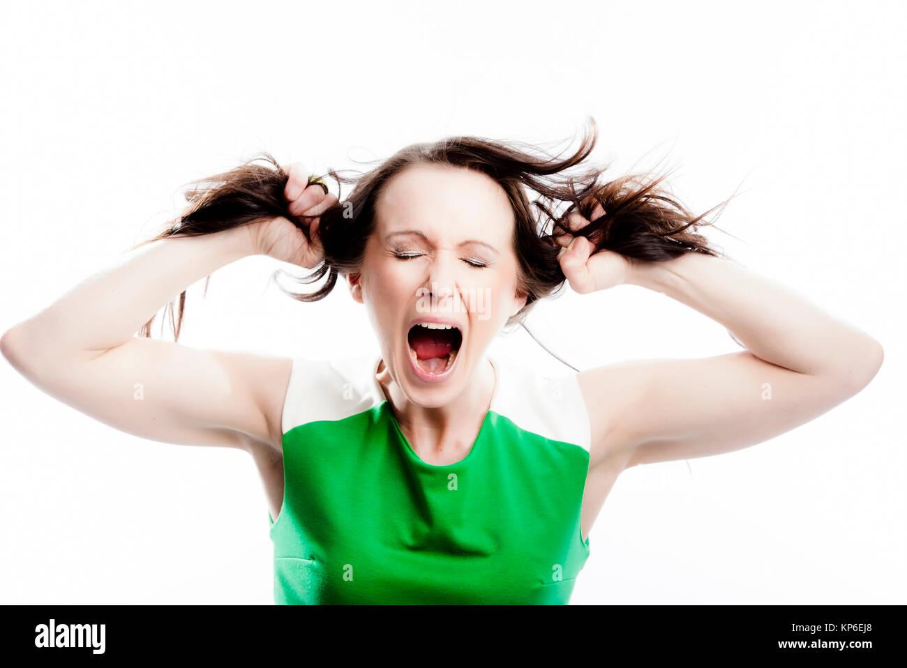 Frau zieht an ihren Haaren - woman with brown hair Stock Photo