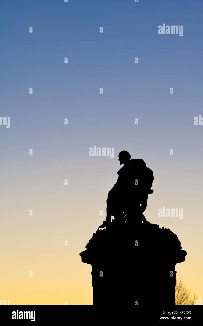 William Shakespeare statue at sunrise. Silhouette. Stratford Upon Avon, Warwickshire, England - Stock Image