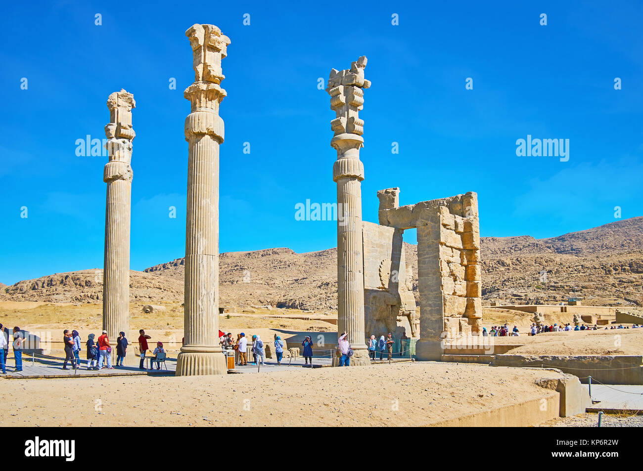 PERSEPOLIS, IRAN - OCTOBER 13, 2017: The tourists pass through the ruins of All Nations Gate (Xerxes Gate), Persepolis Stock Photo