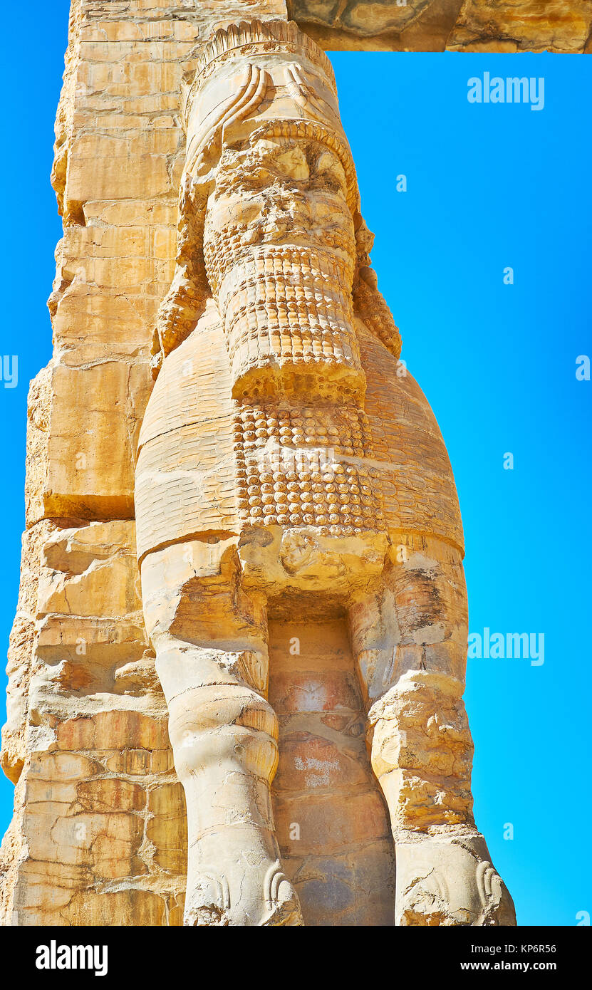 The statue of Assyrian protective deity - Lamassu with preserved carved decors on the Xerxes Gate (All Nations Gate) Stock Photo