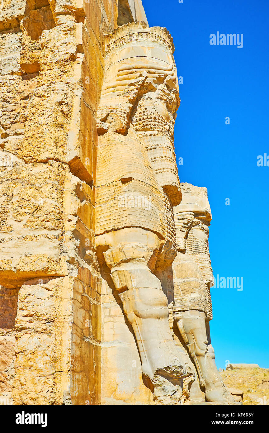 The side view of Lamassu (Assyrian deity) statues, decorating the All Nations Gate (Xerxes Gate) in Persepolis archaeological Stock Photo