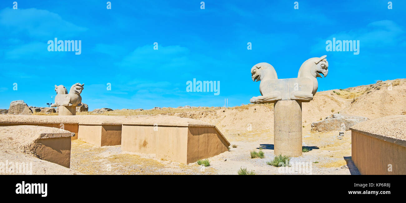 The column capitals with sculptures of griffons in Persepolis archaeological site, Iran. - Stock Image