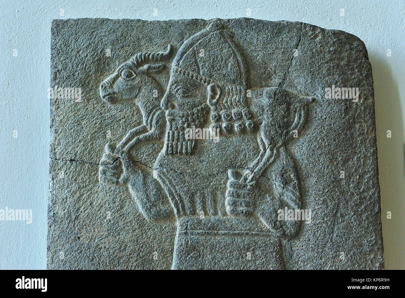 Hittite art: orthostat relief showing a man carrying a gazelle (Zincirli, 8th century BC), Pergamon Museum, Berlin, Stock Photo