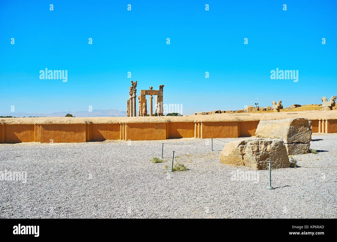 The view on the ancient All Nations (Xerxes) Gate behind the foundations of ruined buildings, Persepolis, Iran. Stock Photo