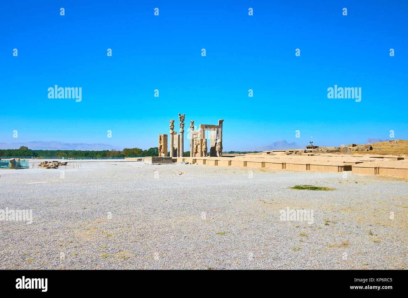 Persepolis archaeological site is located on plateau at the mountain foot, stone ruins of All Nations Gate are perfectly - Stock Image