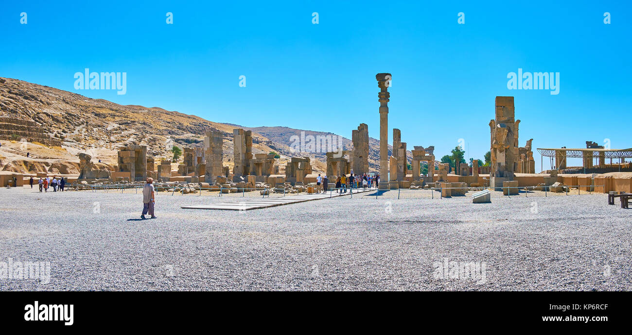 PERSEPOLIS, IRAN - OCTOBER 13, 2017: Panorama of stone Persepolis palace complex, the ruins of Hundred Columns Hall - Stock Image