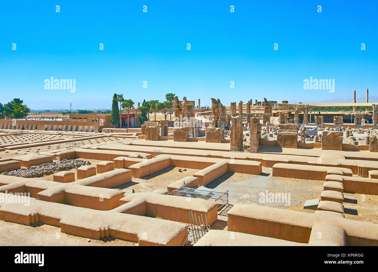 The building of Persepolis Treasury located behind the buildings' foundations and is neighboring with ruined - Stock Image