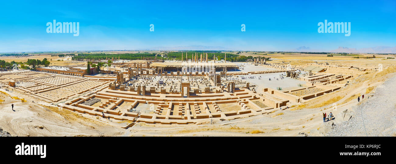 PERSEPOLIS, IRAN - OCTOBER 13, 2017: The wide panorama of Persepolis archaeological site from the viewpoint on the - Stock Image