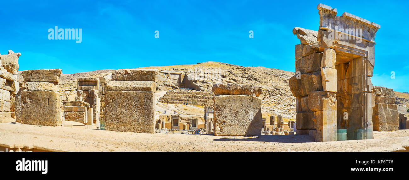 Panorama of Persepolis archaeological site with the view on Artaxerxes III tomb on the rocky slope of Rahmet Mount, - Stock Image