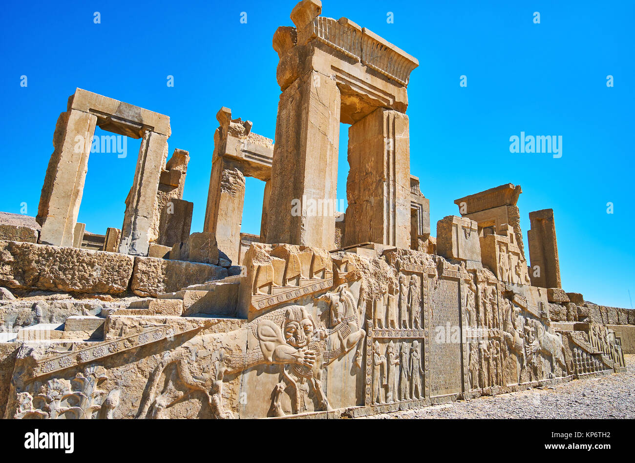 Persepolis archaeological site boasts preserved reliefs, depicting classical scenes, such as lion biting the bull, - Stock Image