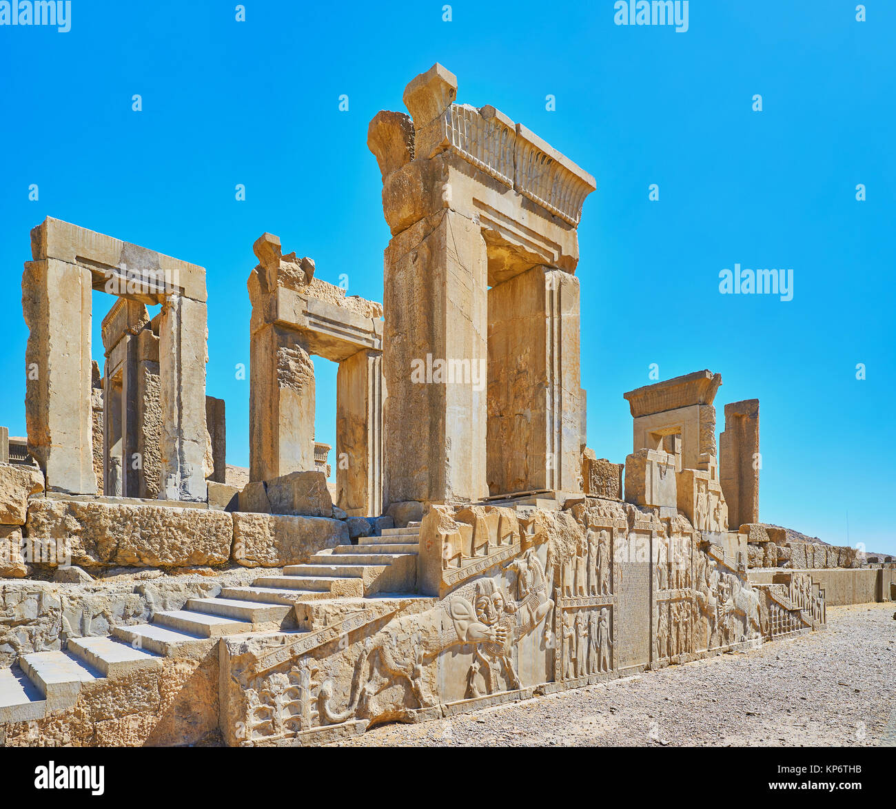 The ancient ruins of Tachara palace in Persepolis archaeological site with preserved reliefs and carved decors, - Stock Image