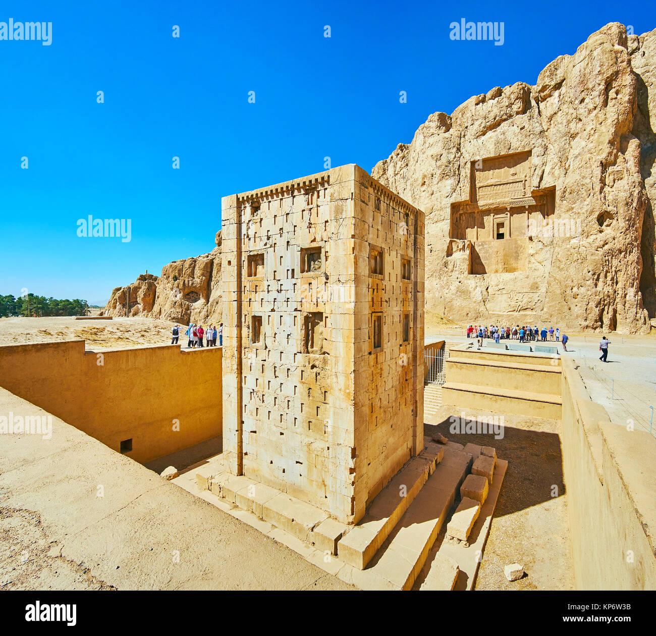 NAQSH-E RUSTAM, IRAN - OCTOBER 13, 2017: Discover Ka'ba-ye Zartosht tower and ancient mausoleums in rock in - Stock Image
