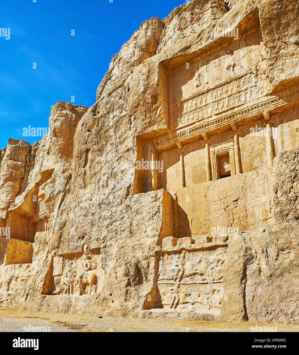 Naqsh-e Rustam Necropolis is popular archaeological zone in Fars Province of Iran, located next to Persepolis. Stock Photo