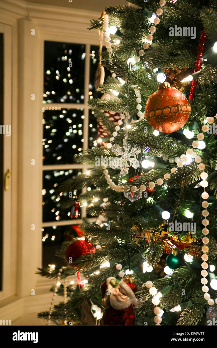 Branches of old fashioned Christmas tree trimmed with pearls and an ...
