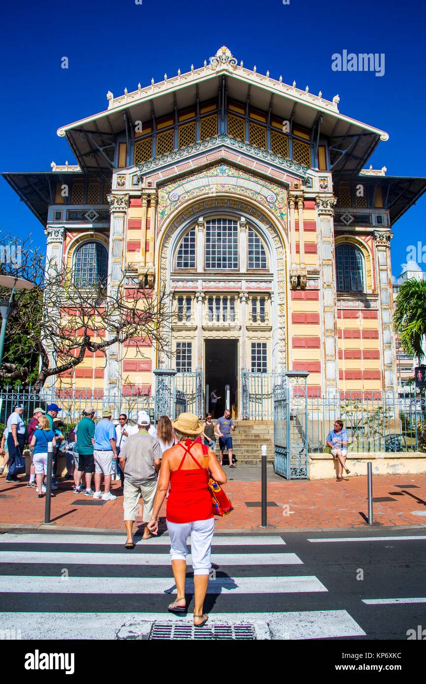 The famous national library of Fort de France in Martinique. Caucasian retired blond Woman with red top and straw - Stock Image