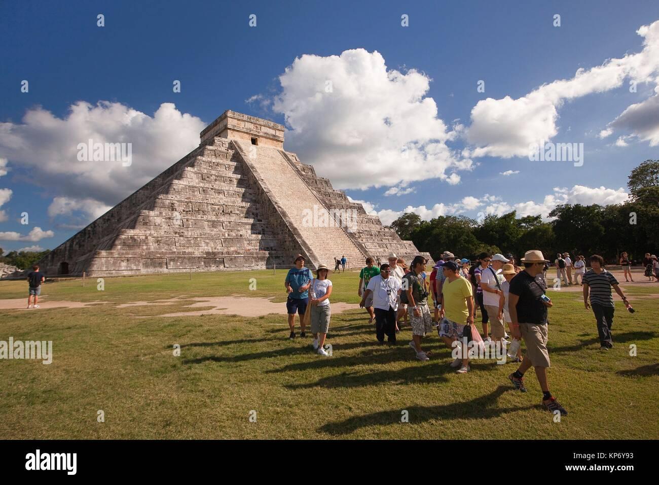 Tourist walking around the Pyramid of Kukulcan-El Castillo, Maya Archeological Site, Chichen Itza, Yucatan Province, - Stock Image