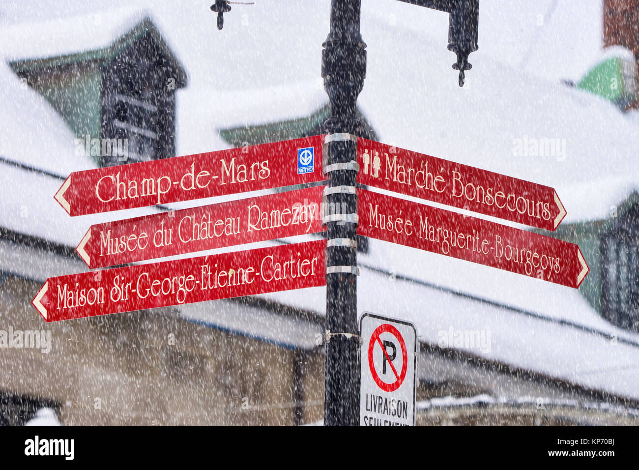 Montreal,Canada,13 December,2017. Close Up Of Street Signs In Old Montreal  During A Snowstorm.Credit:Mario Beauregard/Alamt Live News