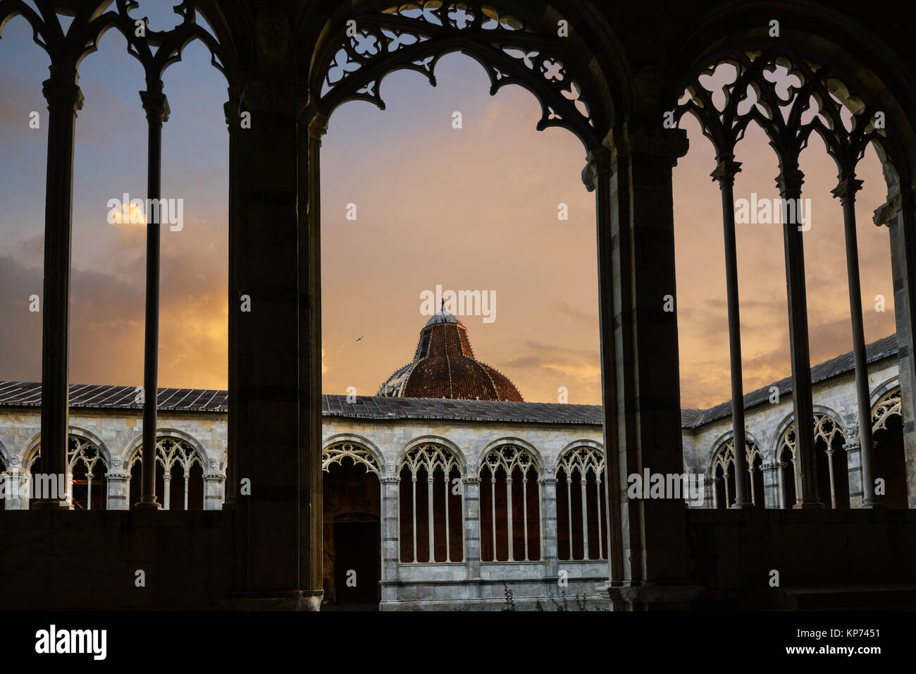 The dome of the baptistery from the Camposanto on the Piazza del duomo in Pisa Italy Stock Photo