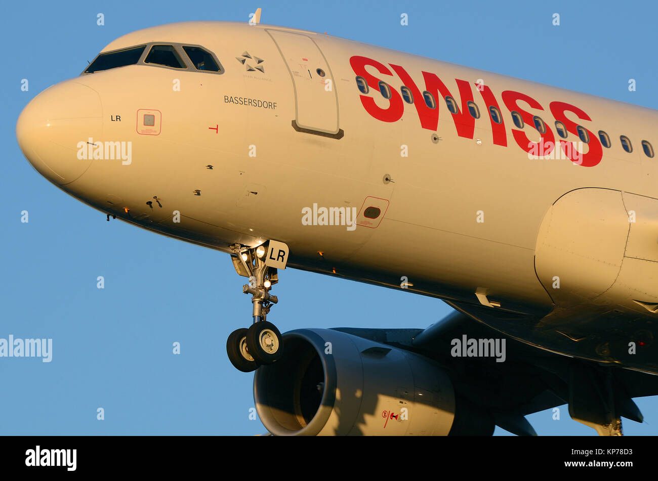 Swiss Airbus A320-200 jet plane HB-JLR named Bassersdorf landing at London Heathrow Airport, UK. Space for copy - Stock Image