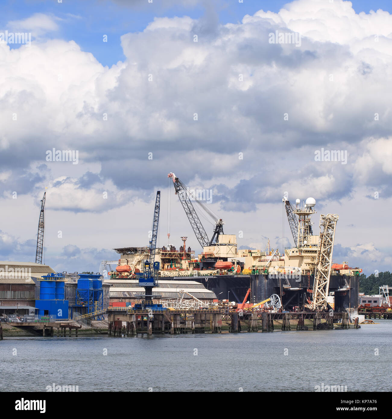 Off-shore vessel in a dock for maintenance work, Port of Rotterdam, The Netherlands - Stock Image
