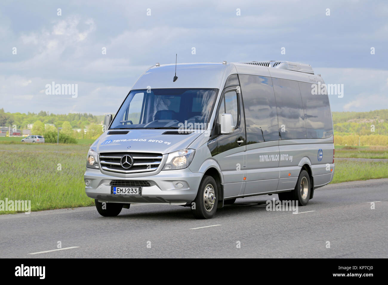 SALO, FINLAND - JUNE 7, 2015: Mercedes-Benz Sprinter minibus transports passengers. The MB Sprinter has a seating - Stock Image