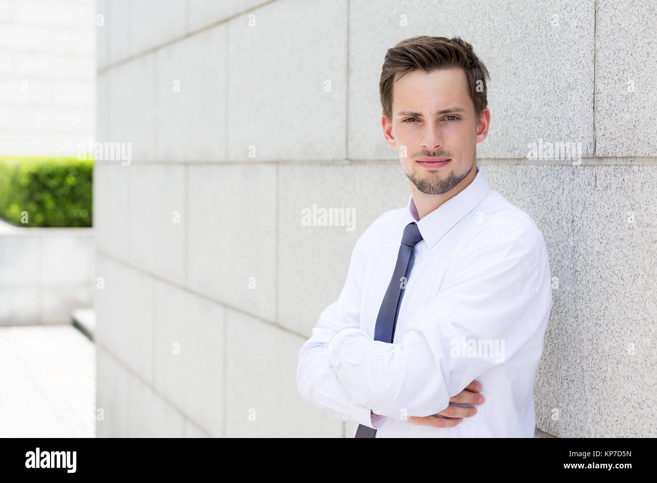 Caucasian businessman standing outside Stock Photo