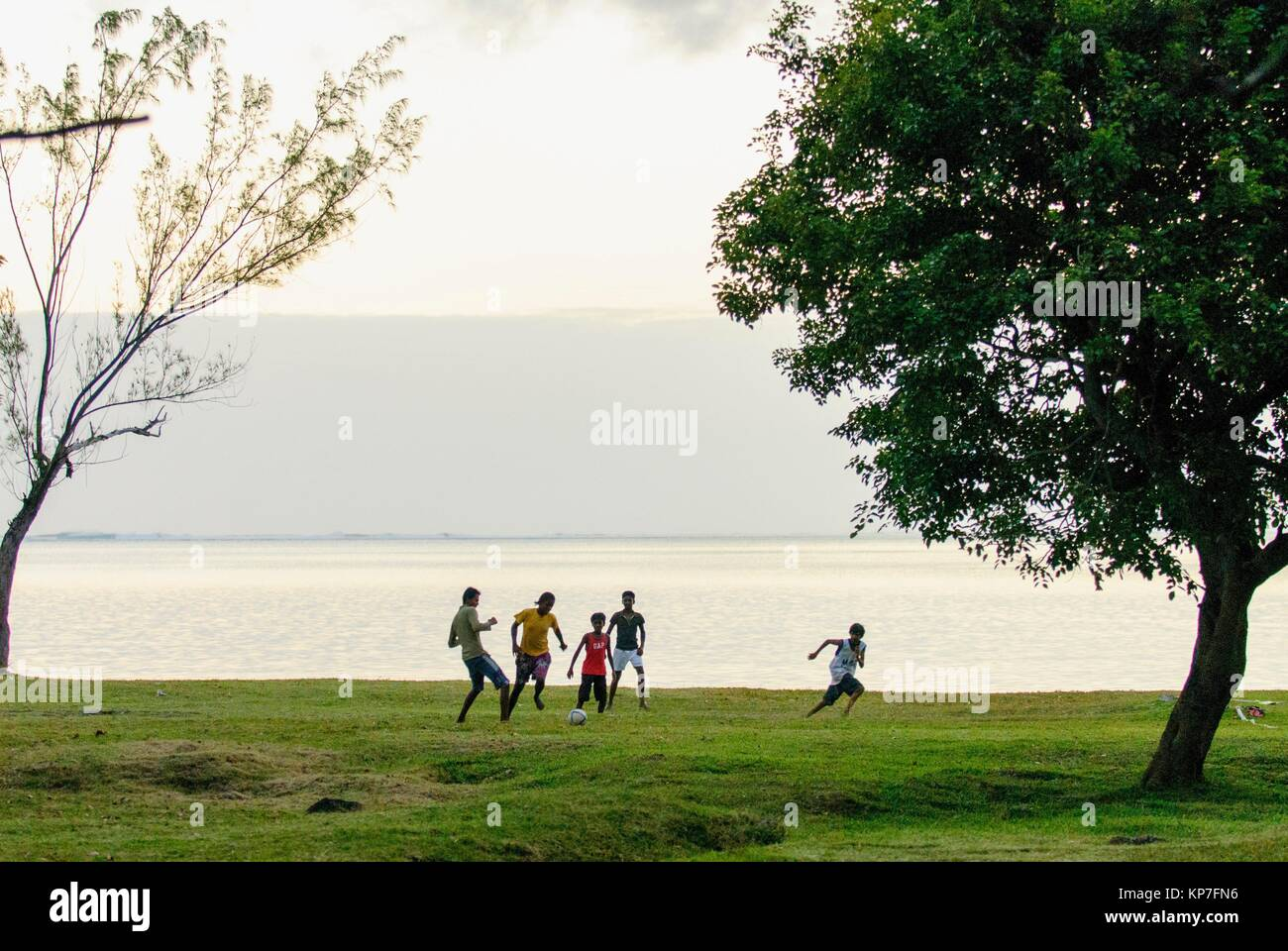 Youngs of Le Morne Village playing football, Le Morne Brabant (UNESCO World Heritate Site), Mauritius, Indian Ocean, - Stock Image