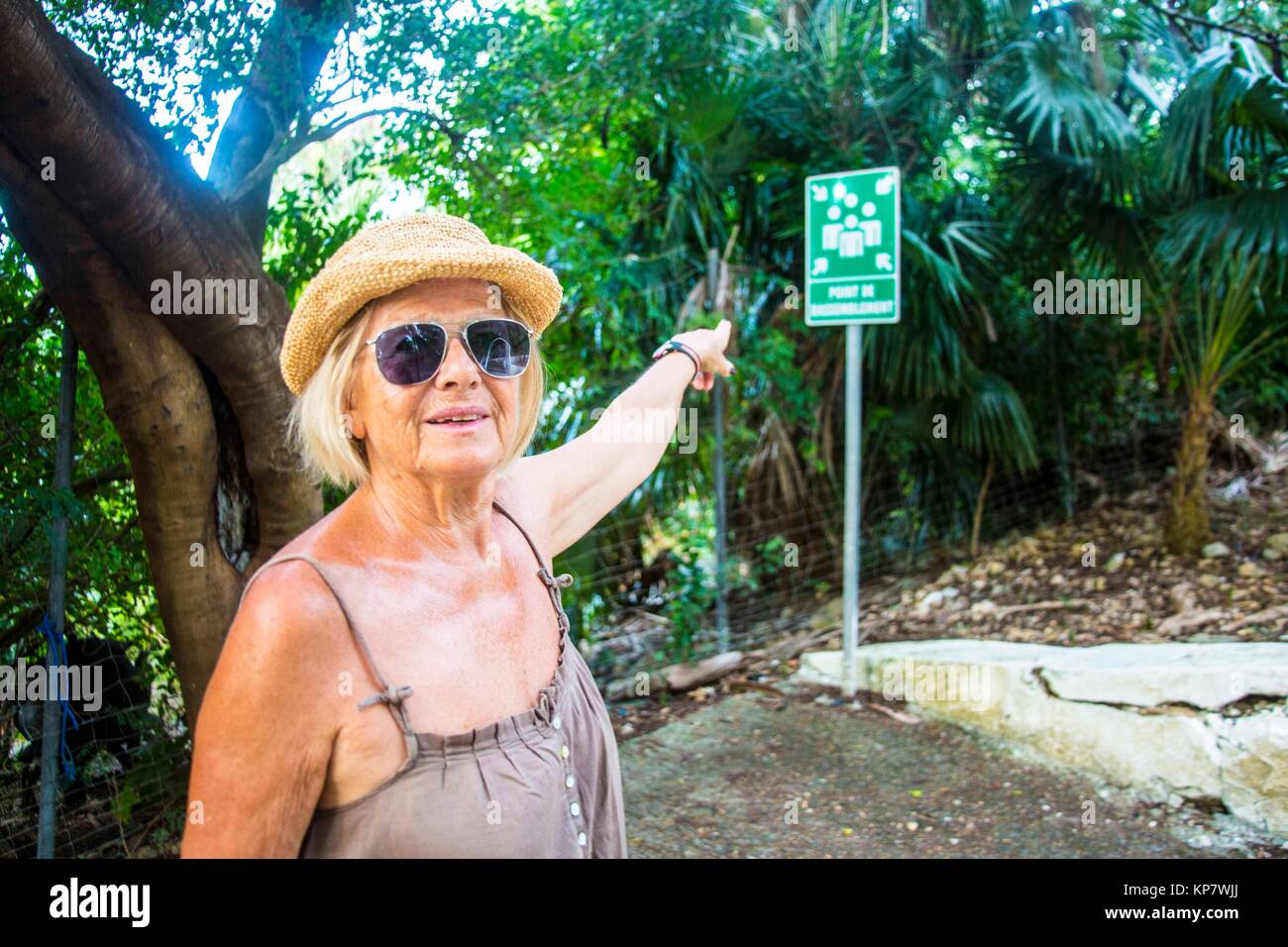 Senior retirred caucasian woman in her 60's, 70's doing the road of christ in Martinique. - Stock Image