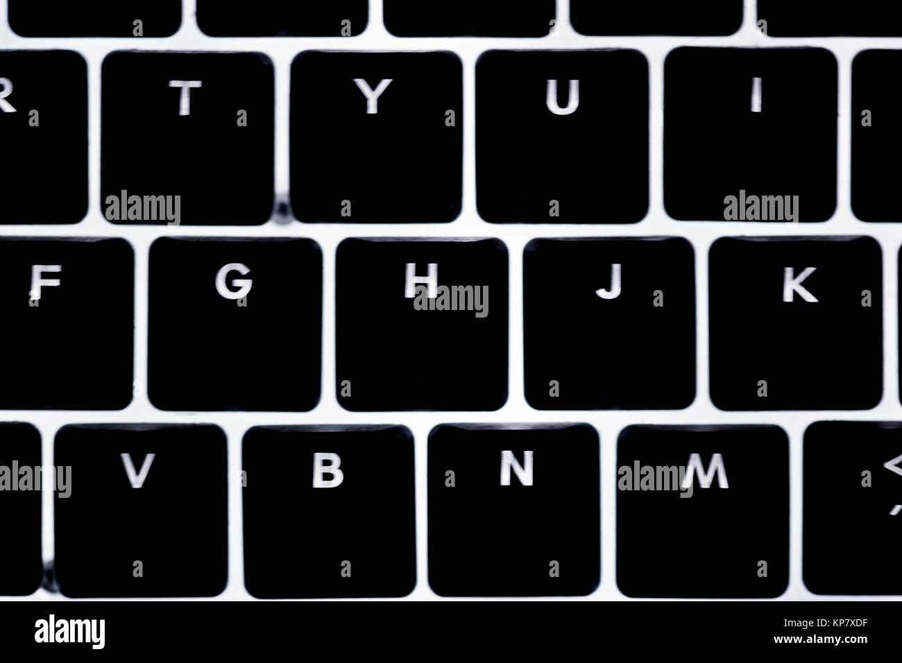 closeup computer illuminated keyboard - Stock Image