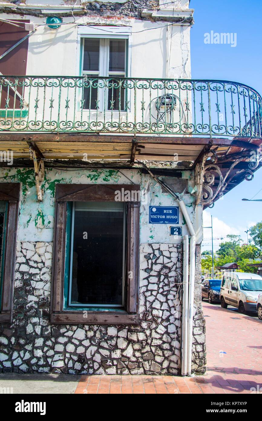 Old houses with signs in the streets of Fort-de-France in Martinique. - Stock Image