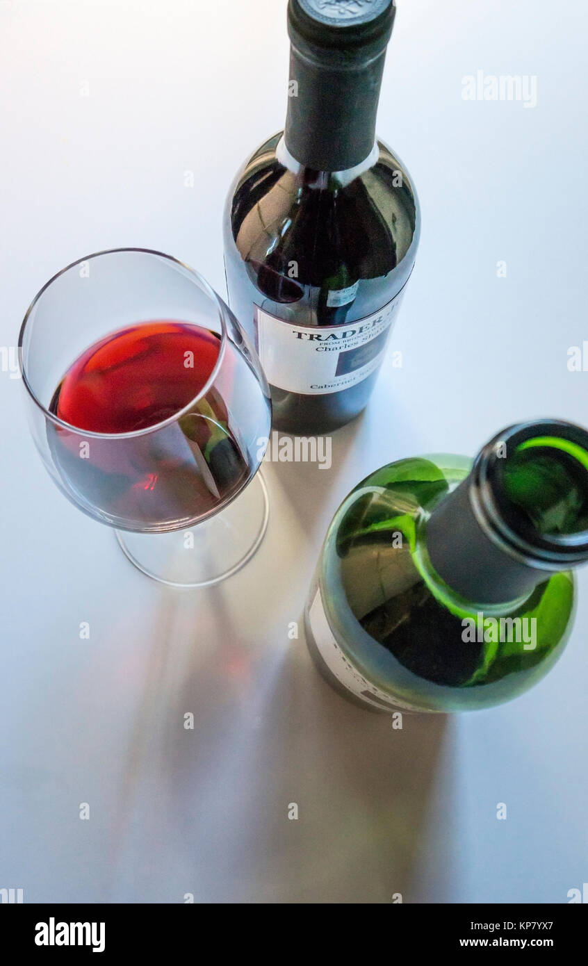 Tow bottles of Cabernet Sauvignon red wine and a pour in a stemmed glass - Stock Image