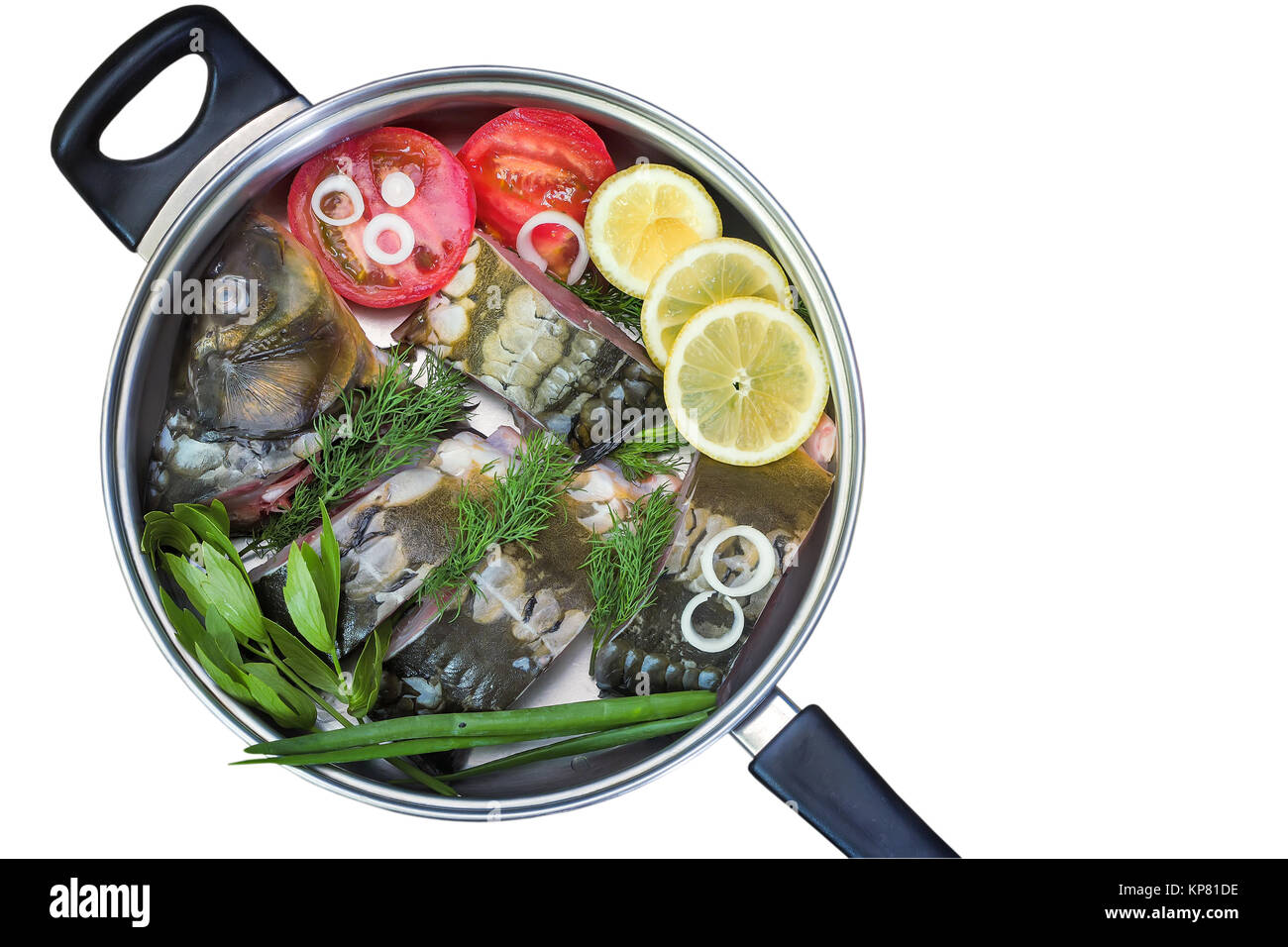 Fish and components for her preparation in a large skillet. - Stock Image