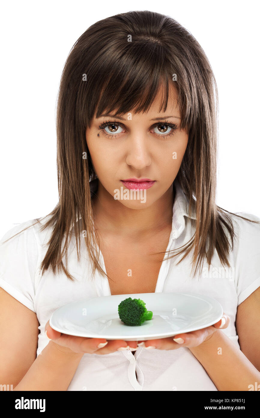 Young woman unhappy for eating healthy Stock Photo