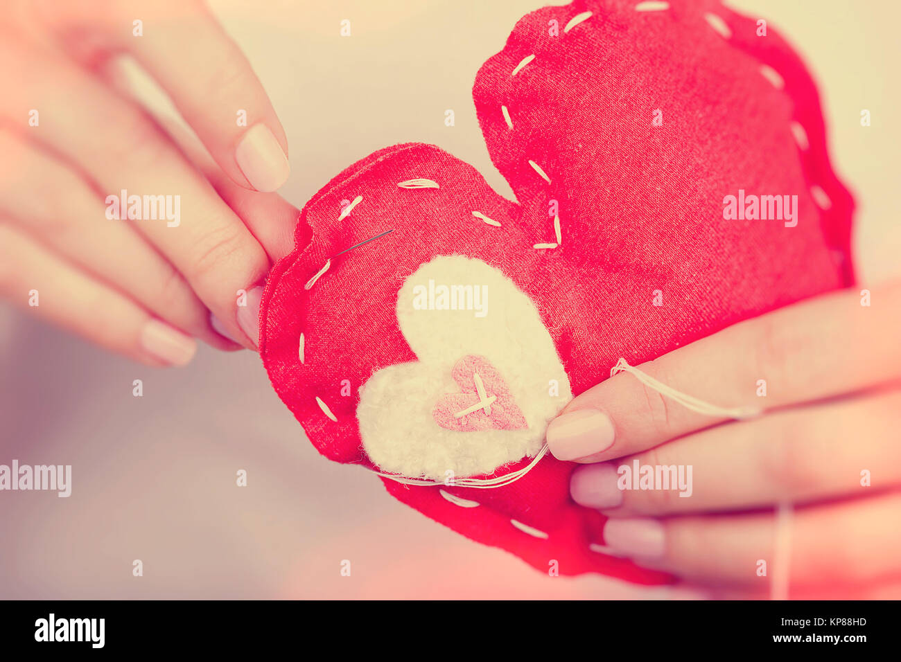 Sewn red heart toy - Stock Photo