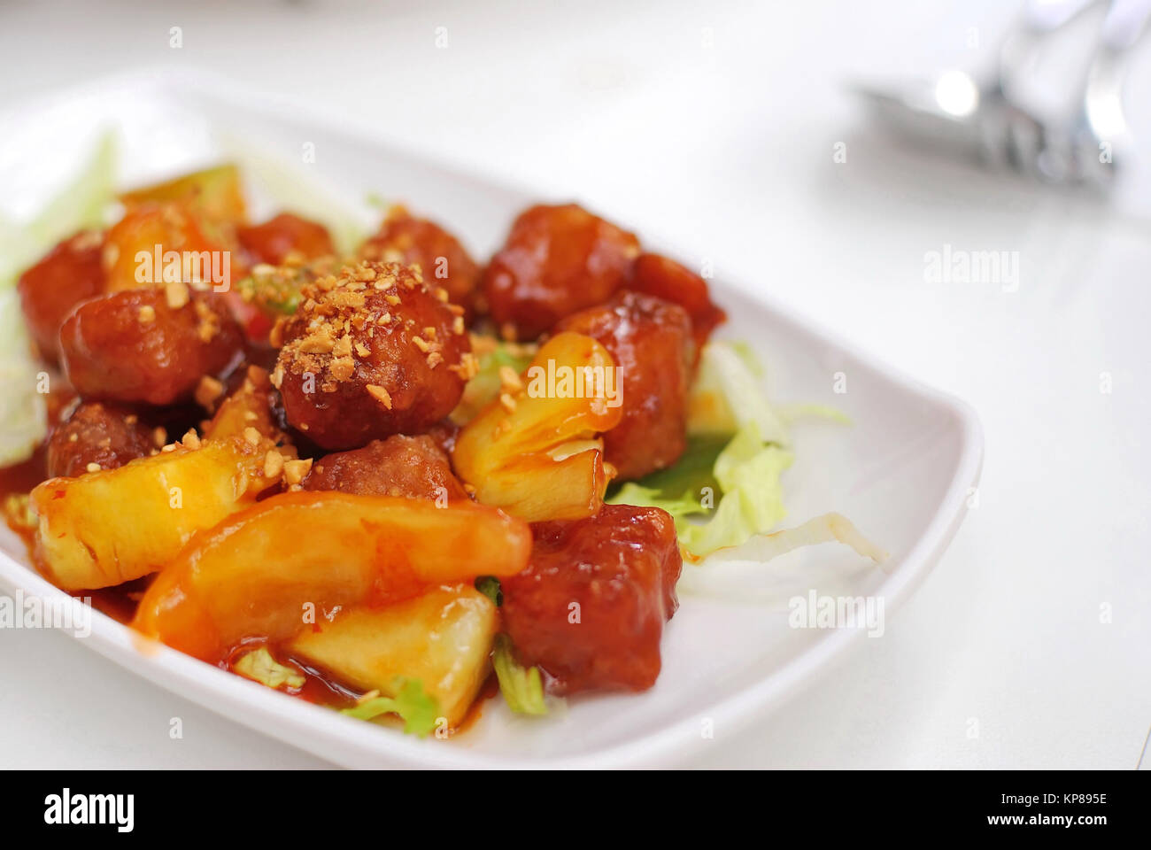 Chinese vegetarian sweet and sour pork cuisine. Ingredients include deep fried mock meat and peppers. Suitable for - Stock Image