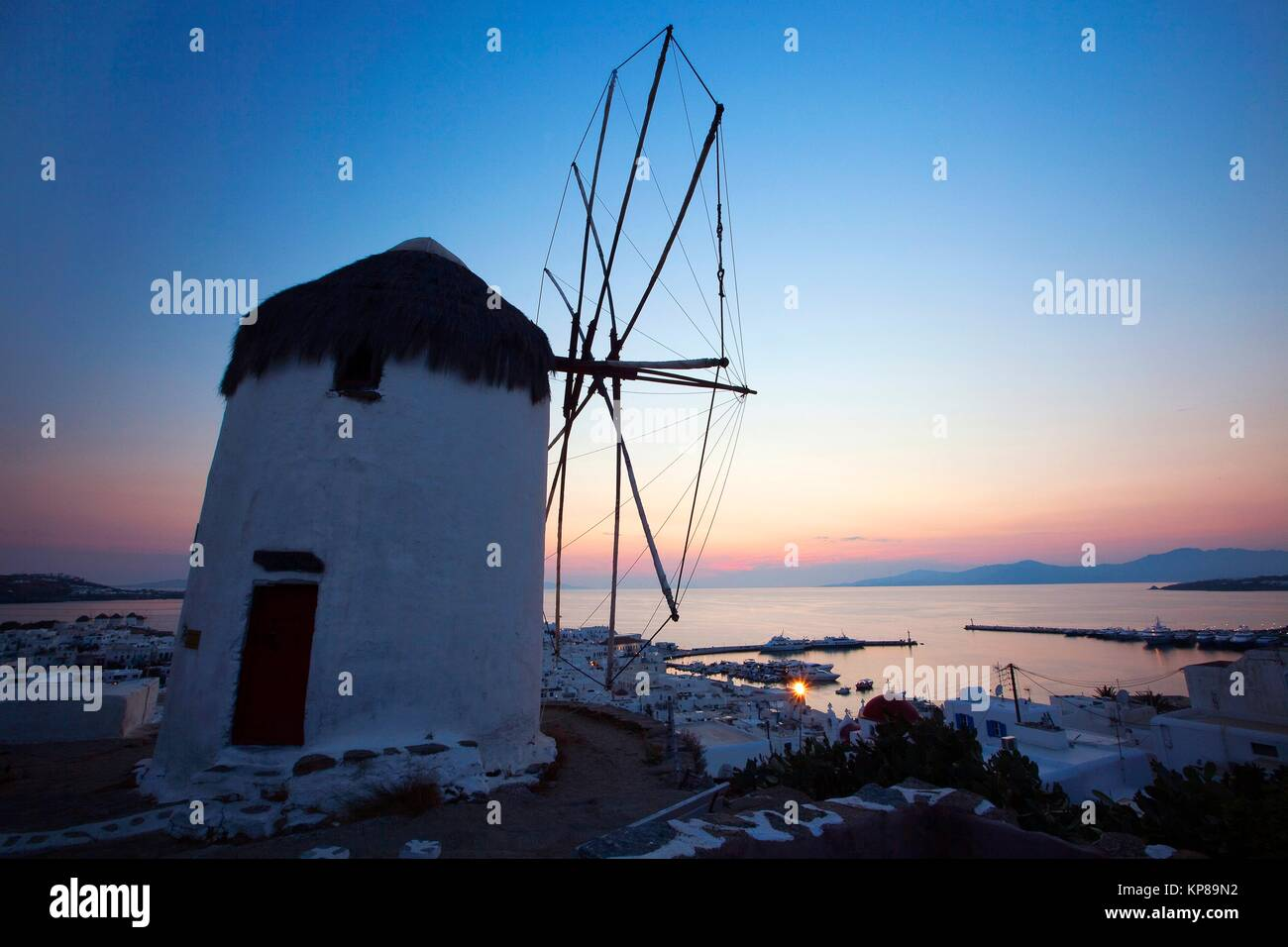 Traditional windmill called Bonis used as Folk Museum on the hill above the town center at the blue hour, Mykonos, - Stock Image