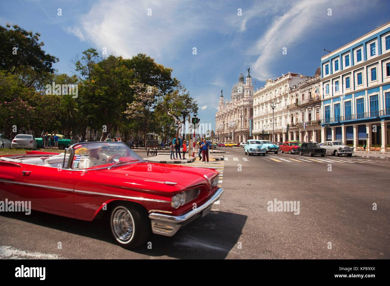 Vintage American car used as taxi in Central Havana with the Hotel Telegrafo, Hotel Inglaterra, Gran Teatro and - Stock Image